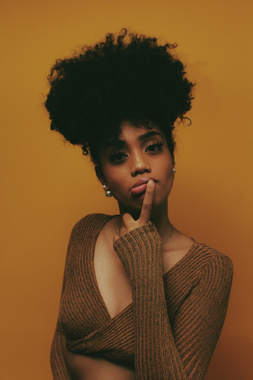 black woman, curly hair, and model image