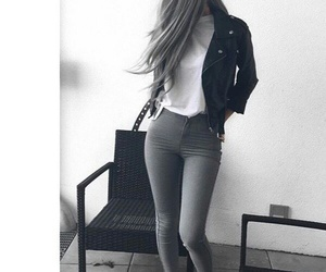 black leather jacket, grey skinny jeans, and white sneakers image