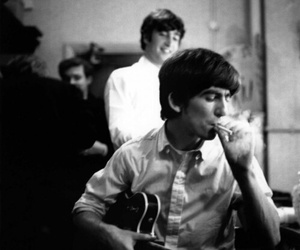 george harrison, john lennon, and the beatles image