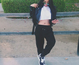 black sneakers, circle sunglasses, and black leather jacket image