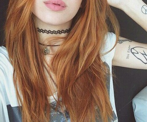 septum piercing, white t-shirt, and arm tattoos image
