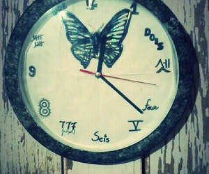 black, clock, and butterfly image