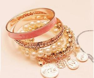 golden bow shape belt, trendy alloy rings, and charm beads stack bangles image