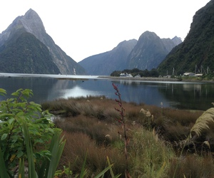 lake, milford sound, and mountains image