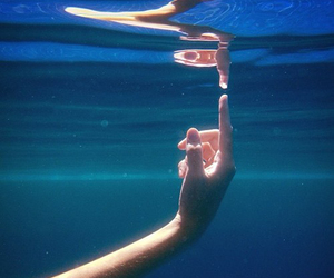 water, blue, and hand image