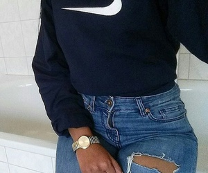 gold watches, blue ripped jeans, and navy blue sweatshirt image