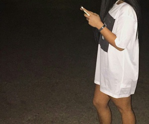 long straight black hair, taupe sneakers, and white oversized t-shirt image
