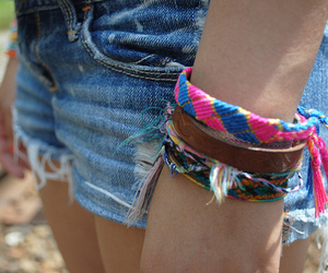 bracelet, shorts, and jeans image