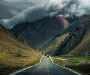 road, clouds, and mountains image