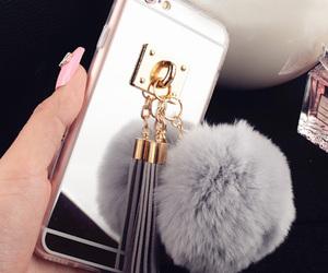 pom pom, tassel, and phone case image
