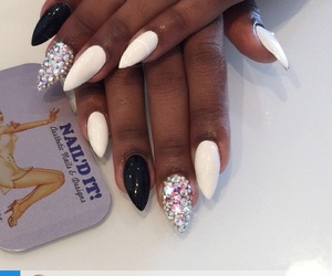 black, white, and rhinestone nails image