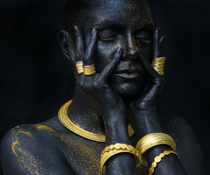 model and black and gold. image