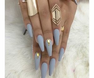 blue nails, gold rings, and white fur image