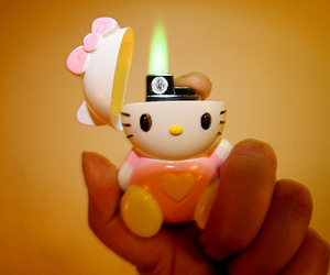 hello kitty, lighter, and fire image