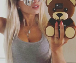belly button piercing, long straight blonde hair, and grey crop tank top image