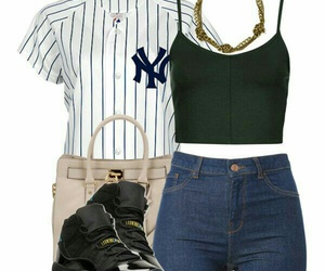 black sneakers, gold chains, and blue high waisted shorts image
