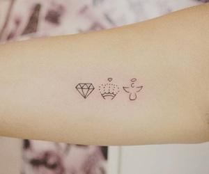 arm tattoo, tattoo, and crown tattoo image