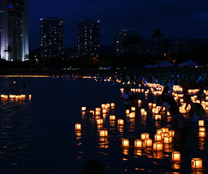 city skyline, lanterns, and water image