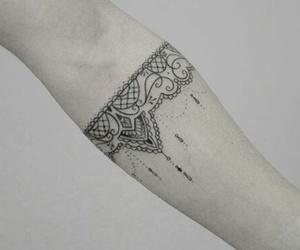 tattoo and bracelete image