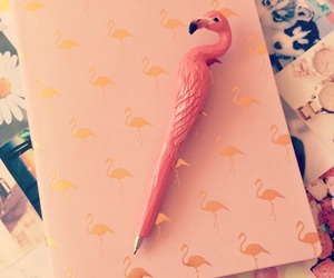 book, flamingo, and pen image