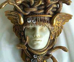 brooch, medusa, and sculpture image