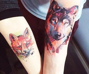 wolf, fox, and tattoo image