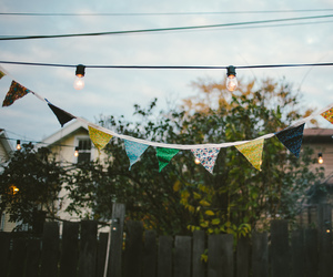 bunting, fence, and lights image