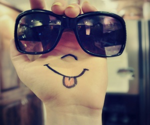 smile, hand, and sunglasses image