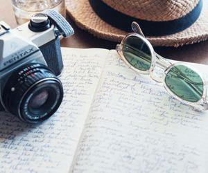 camera, hat, and sunglasses image