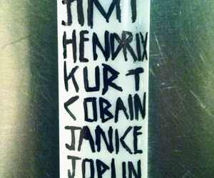 Jimi Hendrix, kurt cobain, and lighter image