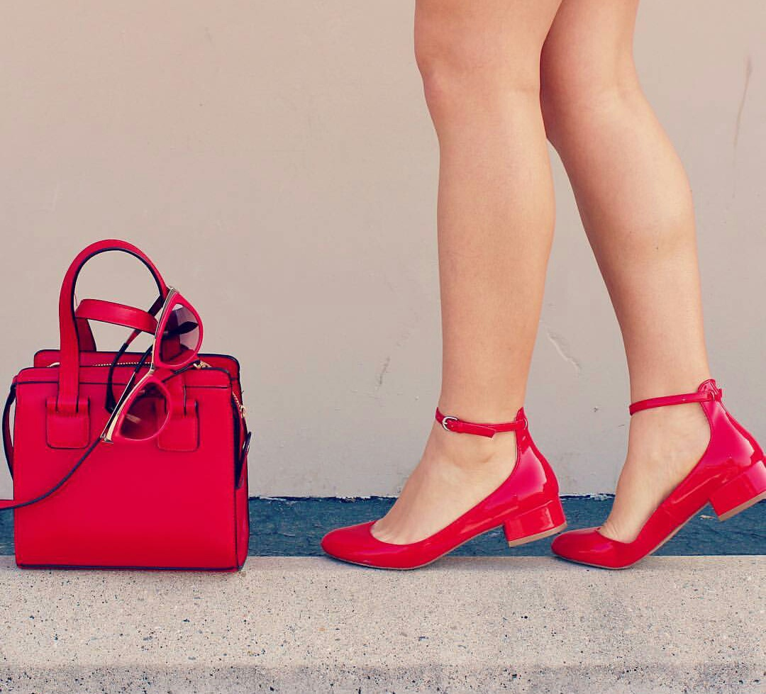 red flats, red sunglasses, and red purse image