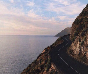 road, mountains, and sea image
