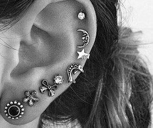ear, piercing, and earrings image