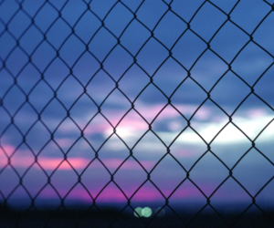 fence and sky image