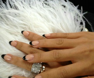 diamond rings, silver rings, and long almond nails image