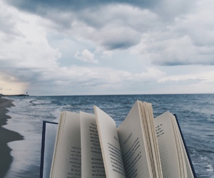 book, sea, and beach image