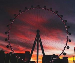 sunset, sky, and ferris wheel image