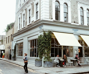 building, cafe, and people image