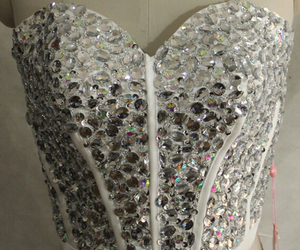 beaded crop top and sparkly corset top image