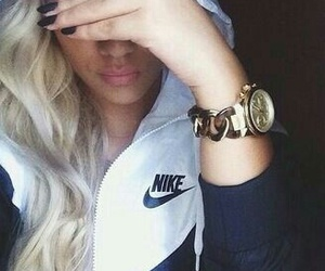 black nails, pink lipstick, and gold watches image