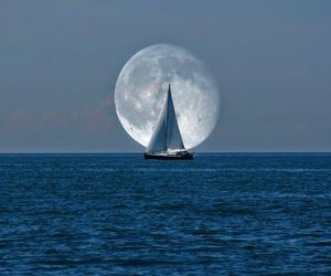 moon, ocean, and boat image