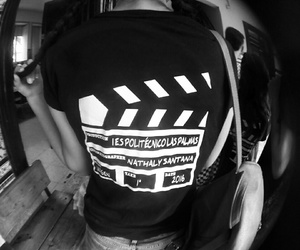t-shirt, filming, and clapperboard image