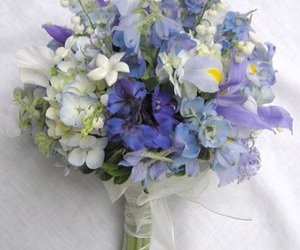 bridal bouquet, wedding party flowers, and wedding day flowers image