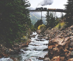 train, nature, and river image