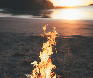fire, beach, and sea image