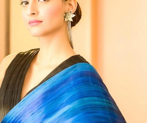 black, blue, and saree image