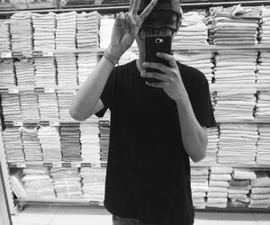 black shirt, nerd, and cap image