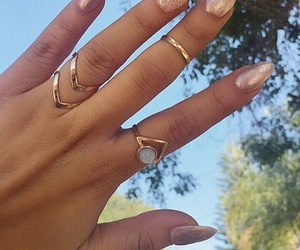 glitter nails, gold rings, and glitter almond nails image