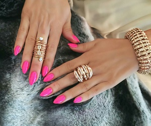 gold rings, hot pink nails, and gold bracelets image