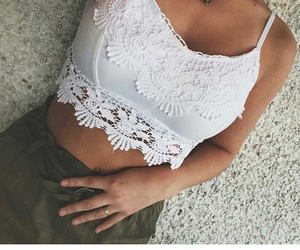 green pants and white lace bralet image